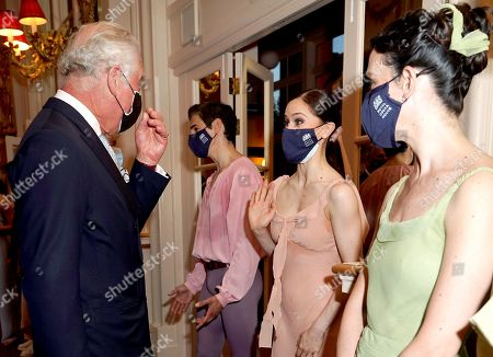 Prince Charles speaking to Royal Ballet dancer Marianela Nunez (2nd right), during a reception held after a performance by The Royal Ballet at the Royal Opera House in central London, to celebrate the return of the arts and entertainment, post lockdown.