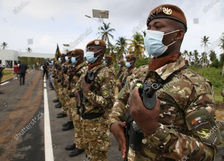 Ivorian soldiers are seen during the inauguration of a new international academy that will train civilian security experts and military officers in the fight against terrorism, in Jacqueville, Ivory Coast, 10 June 2021. The International Academy for the Fight Against Terrorism is based on three distinct and complementary pillars. Namely, a training center for specialized intervention units, an interministerial training school for executives and actors in the fight against terrorism and a research institute dedicated to the study of the terrorist threat, to the sharing of doctrines and to the exchange of experiences.