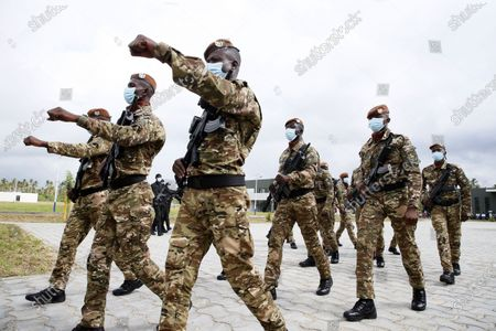Ivorian soldiers parade in the yard of a new international academy that will train civilian security experts and military officers in the fight against terrorism, in Jacqueville, Ivory Coast, 10 June 2021. The International Academy for the Fight Against Terrorism is based on three distinct and complementary pillars. Namely, a training center for specialized intervention units, an interministerial training school for executives and actors in the fight against terrorism and a research institute dedicated to the study of the terrorist threat, to the sharing of doctrines and to the exchange of experiences.