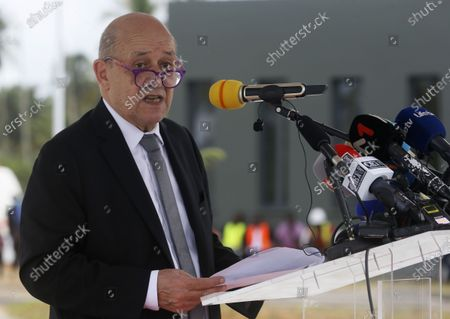 French Foreign Affairs Minister Jean-Yves Le Drian speaks during the inauguration of a new international academy that will train civilian security experts and military officers in the fight against terrorism, in Jacqueville, Ivory Coast, 10 June 2021. The International Academy for the Fight Against Terrorism is based on three distinct and complementary pillars. Namely, a training center for specialized intervention units, an interministerial training school for executives and actors in the fight against terrorism and a research institute dedicated to the study of the terrorist threat, to the sharing of doctrines and to the exchange of experiences.