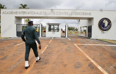 An Ivorian soldier stands guard at the entrance of a new international academy that will train civilian security experts and military officers in the fight against terrorism, in Jacqueville, Ivory Coast, 10 June 2021. The International Academy for the Fight Against Terrorism is based on three distinct and complementary pillars. Namely, a training center for specialized intervention units, an interministerial training school for executives and actors in the fight against terrorism and a research institute dedicated to the study of the terrorist threat, to the sharing of doctrines and to the exchange of experiences.