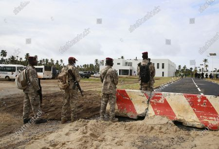 Ivorian soldiers are seen in the yard of the new international academy that will train civilian security experts and military officers in the fight against terrorism, in Jacqueville, Ivory Coast, 10 June 2021. The International Academy for the Fight Against Terrorism is based on three distinct and complementary pillars. Namely, a training center for specialized intervention units, an interministerial training school for executives and actors in the fight against terrorism and a research institute dedicated to the study of the terrorist threat, to the sharing of doctrines and to the exchange of experiences.