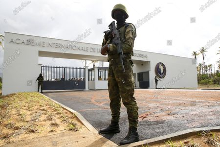 Ivorian soldiers stands guard at the entrance of a new international academy that will train civilian security experts and military officers in the fight against terrorism, in Jacqueville, Ivory Coast, 10 June 2021. The International Academy for the Fight Against Terrorism is based on three distinct and complementary pillars. Namely, a training center for specialized intervention units, an interministerial training school for executives and actors in the fight against terrorism and a research institute dedicated to the study of the terrorist threat, to the sharing of doctrines and to the exchange of experiences.