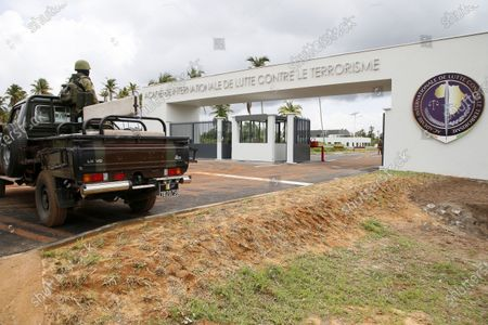 Ivorian soldiers guard the entrance of a new international academy that will train civilian security experts and military officers in the fight against terrorism, in Jacqueville, Ivory Coast, 10 June 2021. The International Academy for the Fight Against Terrorism is based on three distinct and complementary pillars. Namely, a training center for specialized intervention units, an interministerial training school for executives and actors in the fight against terrorism and a research institute dedicated to the study of the terrorist threat, to the sharing of doctrines and to the exchange of experiences.
