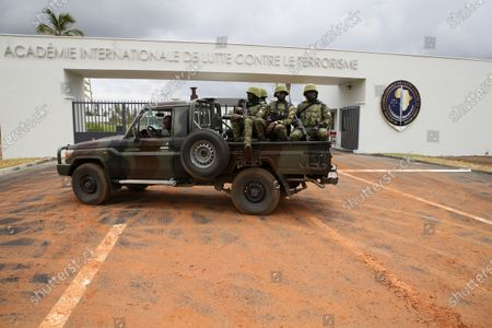 Stock Image of Ivorian soldiers guard the entrance of a new international academy that will train civilian security experts and military officers in the fight against terrorism, in Jacqueville, Ivory Coast, 10 June 2021. The International Academy for the Fight Against Terrorism is based on three distinct and complementary pillars. Namely, a training center for specialized intervention units, an interministerial training school for executives and actors in the fight against terrorism and a research institute dedicated to the study of the terrorist threat, to the sharing of doctrines and to the exchange of experiences.