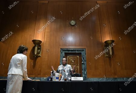 WASHINGTON, DC - JUNE 10: United States Senator Susan Collins (Republican of Maine), left, greets United States Secretary of Housing and Urban Development, Marcia Fudge before a Senate appropriations budget hearing with the Subcommittee on Transportation, Housing and Urban Development and related agencies at the Dirksen Senate Office Building in Washington, DC.