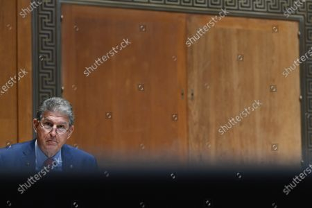 WASHINGTON, DC - JUNE 10: United States Senator Joe Manchin III (Democrat of West Virginia) is seen as United States Secretary of Housing and Urban Development, Marcia Fudge appears during a Senate appropriations budget hearing with the Subcommittee on Transportation, Housing and Urban Development and related agencies at the Dirksen Senate Office Building in Washington, DC.