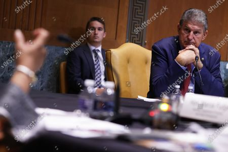 WASHINGTON, DC - JUNE 10: U.S. Sen. Joe Manchin (D-WV) (R) listens to Secretary of House and Urban Development Secretary Marcia Fudge during a hearing before Transportation, Housing and Urban Development, and Related Agencies Subcommittee of Senate Appropriations Committee at Dirksen Senate Office Building on Capitol Hill in Washington, DC. The subcommittee held the hearing to review President Joe Biden's FY2022 budget request for HUD.