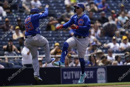 Chicago Cubs' Joc Pederson reacts after hitting a home run during the fourth inning of a baseball game against the San Diego Padres, in San Diego
