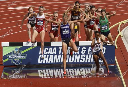 Runners compete in a women's 3,000-meter steeplechase semifinal during the NCAA Division I Outdoor Track and Field Championships, at Hayward Field in Eugene, Ore. Washington's Katie Rainsberger is at center; Auburn's Joyce Kimeli is at right front
