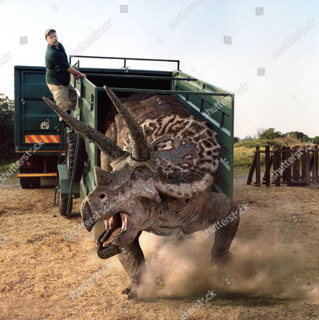 Pictured:  Park Keeper Rod Arthur releases a Triceratops .