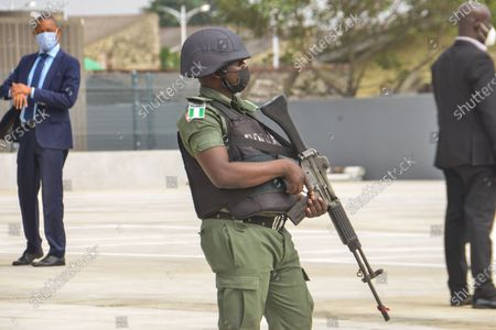 A security man stand on guard before the arrival of Nigerian President, Muhammad Buhari at the newly commissioned Mobolaji Johnson Railway Station in Ebutemeta, Lagos, Nigeria, on June 10, 2021. President Muhammadu Buhari on Thursday visited Lagos for the inauguration of the 157-kilometer Lagos-Ibadan standard rail project at the Mobolaji Johnson railway station in Ebutte Metta. The Construction which started in March 2017, and test-running commenced in December 2020. The Ebute Metta Station, known as the Mobolaji Johnson Station, is the largest railway station in West Africa with a holding capacity of 6000 passengers A statement from the precedential aide ''''Femi Adesina''.  ''President Buhari is committed to developing a modern national railway network that will connect every part of Nigeria, and promote trade, travel, tourism, commerce and national integration.''