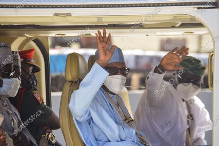 (L-R): Nigeria President, Muhammadu Buhari and Lagos State Governor, Babajide Sonwo-Olu gesture shortly after commissioning the Mobolaji Johnson Railway Station in Ebutemeta, Lagos, Nigeria, on June 10, 2021. President Muhammadu Buhari on Thursday visited Lagos for the inauguration of the 157-kilometer Lagos-Ibadan standard rail project at the Mobolaji Johnson railway station in Ebutte Metta. The Construction which started in March 2017, and test-running commenced in December 2020. The Ebute Metta Station, known as the Mobolaji Johnson Station, is the largest railway station in West Africa with a holding capacity of 6000 passengers A statement from the precedential aide ''''Femi Adesina''.  ''President Buhari is committed to developing a modern national railway network that will connect every part of Nigeria, and promote trade, travel, tourism, commerce and national integration.''