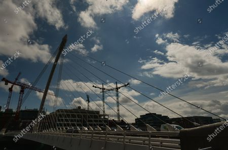 A view of the Samuel Beckett Bridge and construction cranes in the background.On Thursday, 10 June 2021, in Dublin, Ireland.