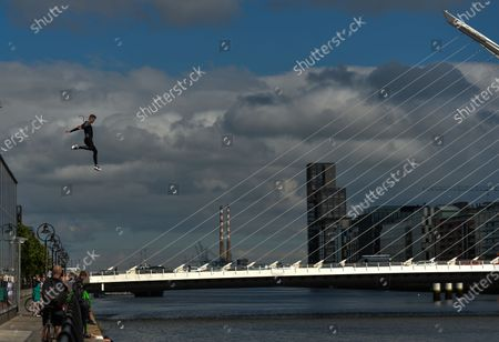 A young man jumps into the Liffey River in Dublin.On Thursday, 10 June 2021, in Dublin, Ireland.