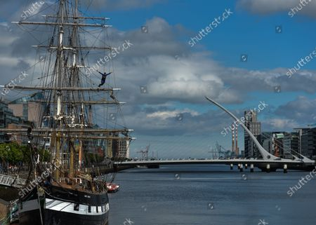 A young man jumps from the Jeanie Johnston ship into the Liffey River in Dublin.On Thursday, 10 June 2021, in Dublin, Ireland.