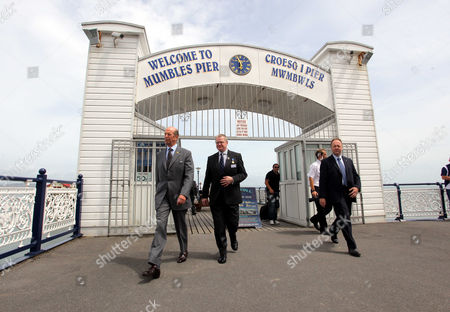 L-R The Duke of Kent walks on Mumbles Pier with Tim Conway of the RNLI