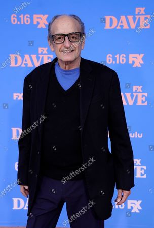 """Guest star David Paymer poses at the season two premiere of the FXX series """"Dave"""" at The Greek Theater, in Los Angeles"""