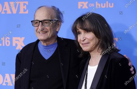 """Guest stars David Paymer, left, and Gina Hecht pose together at the season two premiere of the FXX series """"Dave"""" at The Greek Theater, in Los Angeles"""