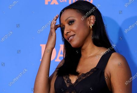 """Guest star Meagan Holder poses at the season two premiere of the FXX series """"Dave"""" at The Greek Theater, in Los Angeles"""