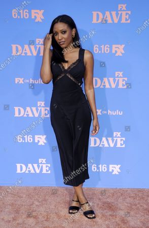 """Meagan Holder, a guest star in the FXX series """"Dave,"""" poses at the season-two premiere of the show at The Greek Theater, in Los Angeles"""