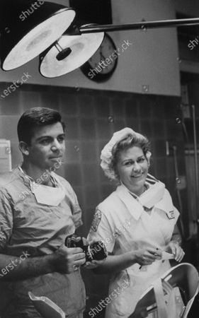 Photographer Robert Gomel (L) with Life reporter Jan Mason at NYC hospital during birth of 200 millionth American.