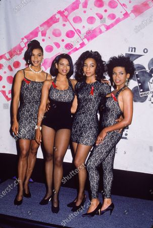 Portrait of popular rhythm and blues vocal group En Vogue as they pose in matching outfits backstage at the first annual MTV Movie Award ceremony, Los Angeles, California, June 22, 1992. Pictured are, from left, American singers Dawn Robinson, Cindy Herron, Terry Ellis, and Maxine Jones.