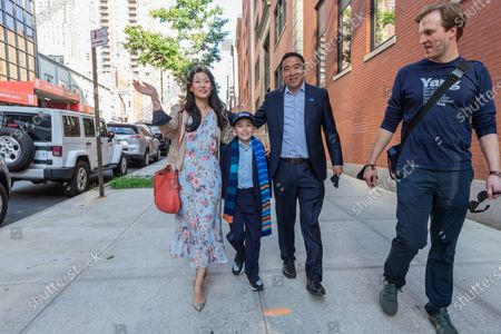 Mayoral candidate Andrew Yang and wife Evelyn Yang arrive for debate at CBS Broadcast Center. He was met by Tyrene Pamstein known as Mini Yang. He greets supporters gathering outside to appreciate their support. CBS invited for debate 5 leading candidates Andrew Yang, Eric Adams, Kathryn Garcia, Scott String and Maya Wiley. Supporters for each candidate staged rally outside CBS center. Upon arrival candidates greeted their supporters.