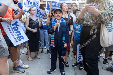 Stock Photo of Tyrene Pamstein known as Mini Yang attends rally at CBS Broadcast Center where supporters gathering before start of the debate. CBS invited for debate 5 leading candidates Andrew Yang, Eric Adams, Kathryn Garcia, Scott String and Maya Wiley. Supporters for each candidate staged rally outside CBS center. Upon arrival candidates greeted their supporters.