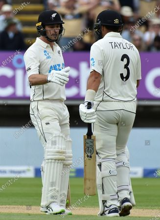 New Zealand's Will Young, left, celebrates with teammate Ross Taylor after scoring fifty runs during the second day of the second cricket test match between England and New Zealand at Edgbaston in Birmingham, England