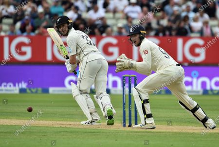 New Zealand's Will Young, left, bats during the second day of the second cricket test match between England and New Zealand at Edgbaston in Birmingham, England