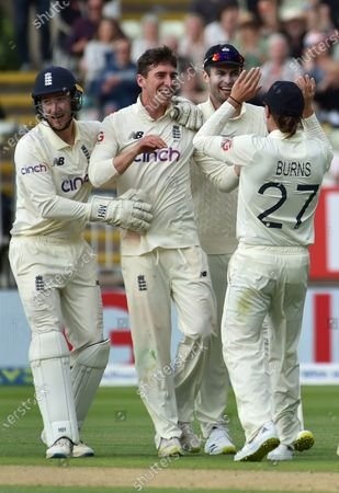 England's Dan Lawrence, second left, celebrates with teammates the dismissal of New Zealand's Will Young during the second day of the second cricket test match between England and New Zealand at Edgbaston in Birmingham, England