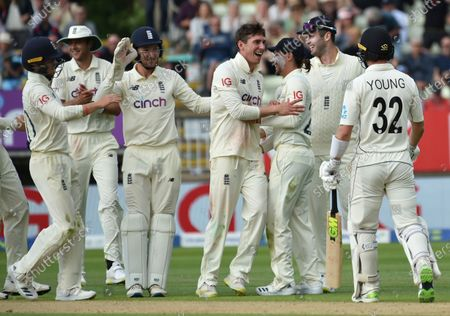 England's Dan Lawrence, center, celebrates with teammates the dismissal of New Zealand's Will Young, right, during the second day of the second cricket test match between England and New Zealand at Edgbaston in Birmingham, England