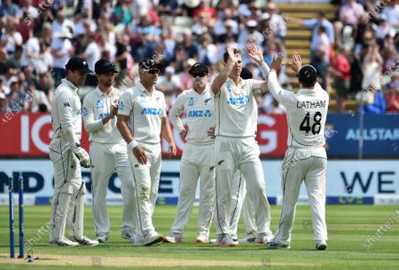 New Zealand's Matt Henry, second right, celebrates with teammates the dismissal of England's Mark Wood during the second day of the second cricket test match between England and New Zealand at Edgbaston in Birmingham, England
