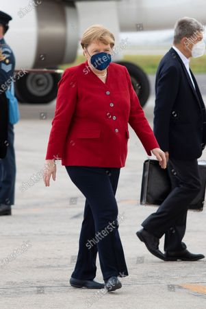 Germany's Chancellor Angela Merkel (C) and her husband, Joachim Sauer (R), arrive ahead of the G7 Summit at Cornwall airport in Newquay, Britain, 11 June 2021. Britain will held the G7 summit in Cornwall in from 11 to 13 June 2021.