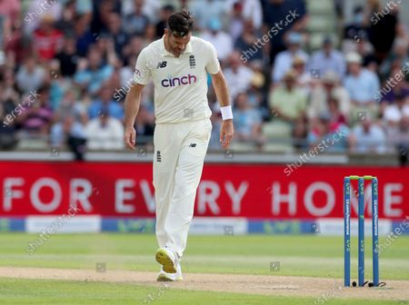Jimmy Anderson of England kcks the ground in frustration