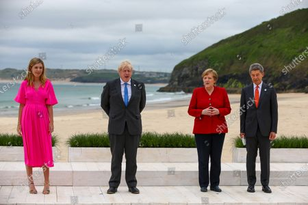 (L-R) Carrie Johnson, wife of U.K. Prime Minister Boris Johnson, Boris Johsnon, U.K. prime minister, Angela Merkel, Germany's chancellor, and her husband Joachim Sauer, on the first day of the Group of Seven (G7) leaders summit in Carbis Bay, Cornwall, Britain, 11 June 2021. Britain hosts the G7 summit in Cornwall in from 11 to 13 June 2021.