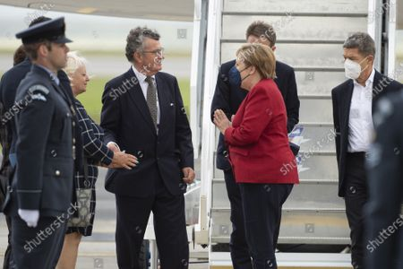 Chancellor of Germany Angela Merkel and her husband, Joachim Sauer, arrive at Cornwall Airport Newquay on June 11, 2021, ahead of the G7 summit in Cornwall.