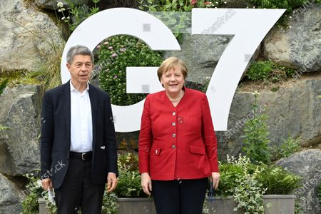German Chancellor Angela Merkel and her husband, Joachim Sauer, arrive at the Carbis Bay Hotel on June 11, 2021, during the G7 summit in Cornwall, United Kingdom.