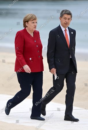 Germany's Chancellor Angela Merkel (L) and her husband Joachim Sauer (R) at the official leaders welcome during the G7 Summit in Carbis Bay, Britain, 11 June 2021. Britain hosts the Group of Seven (G7) summit in Cornwall from 11 to 13 June 2021.