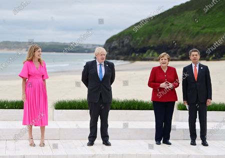 Britain's Prime Minister Boris Johnson (2-L) and his wife Carrie (L) welcome Germany's Chancellor Angela Merkel (2-R) and her husband Joachim Sauer (R) during the G7 Summit in Carbis Bay, Britain, 11 June 2021. Britain will held the G7 summit in Cornwall in from 11 to 13 June 2021.