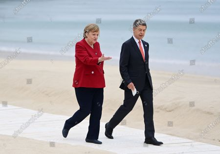 Germany's Chancellor Angela Merkel (L) and her husband Joachim Sauer during the G7 Summit in Carbis Bay, Britain, 11 June 2021. Britain will held the G7 summit in Cornwall in from 11 to 13 June 2021.