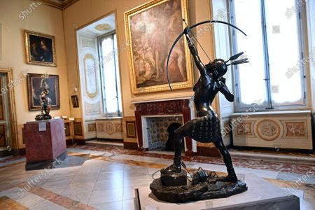 The statue Female Archer at the exhibition by Damien Hirst ' Archaeology Now ' over eighty artworks in the series ' Treasures from the Wreck of the Unbelievable ' are exhibited in all the rooms of the museum alongside the ancient masterpieces in  the Museum Borghese Gallery (Galleria Borghese) in Rome