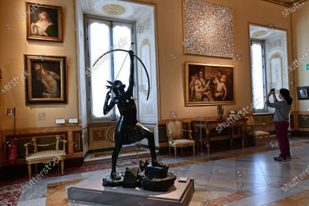 The bronze statue Female Archer at the exhibition by Damien Hirst ' Archaeology Now ' over eighty artworks in the series ' Treasures from the Wreck of the Unbelievable ' are exhibited in all the rooms of the museum alongside the ancient masterpieces in  the Museum Borghese Gallery (Galleria Borghese) in Rome