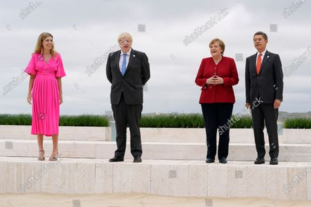 British Prime Minister Boris Johnson and his wife Carrie Johnson pose for photos with German Chancellor Angela Merkel and her husband Joachim Sauer at the G-7 summit, in Carbis Bay, England