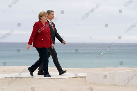 German Chancellor Angela Merkel and her husband Joachim Sauer arrive to pose for photos with British Prime Minister Boris Johnson and his wife Carrie Johnson at the G-7 summit, in Carbis Bay, England