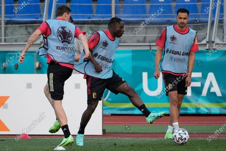 Belgium's Jeremy Doku, center, plays the ball with teammates Hans Vanaken, left, and Nacer Chadli during a training session of the national team at Petrovsky stadium in St. Petersburg, Russia, on the eve of the Euro 2020 soccer championship group B match between Russia and Belgium. The Euro 2020 gets underway on Friday June 11 and is being played in 11 host cities across 11 countries. The event was delayed by one year after being postponed in 2020 due to the COVID-19 pandemic