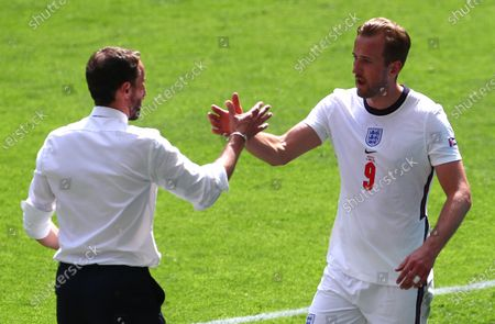 Harry Kane of England is substituted by England manager Gareth Southgate