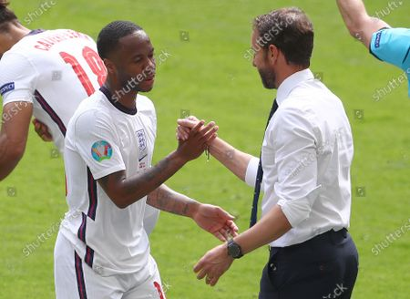 Raheem Sterling of England shakes hands with England manager Gareth Southgate after being substituted