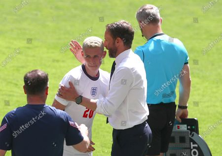 Phil Foden of England is hugged by England manager Gareth Southgate as he is substituted